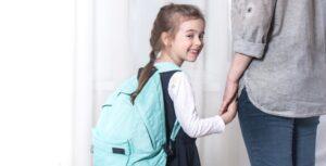 parent-elementary-school-student-go-hand-hand-light-background-back-school-concept